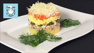 Слоёный салат с рыбой и овощами.